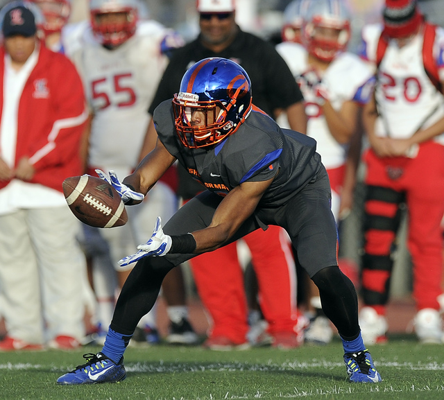 Bishop Gorman wide receiver kick returner Cordell Broadus (21) catches a pass in the second half of the Division I state football semifinal game against Liberty at Rancho on Saturday. Gorman defea ...