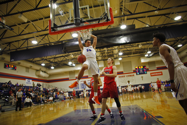 Bishop Gorman's forward Saxton Howard (14) dunks against Coronado during a basketball game at Bishop Gorman High School on Tuesday, Dec. 6, 2016, in Las Vegas. (Rachel Aston/Las Vegas Review-Journ ...