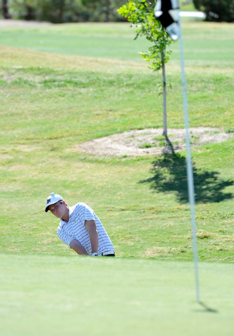 Shadow Ridge's Benjamin Davis shoots for the green on the fifth hole during the final round of the Sunset Region championship tournament on Tuesday. Davis shot 142 and won the tournament on a two- ...