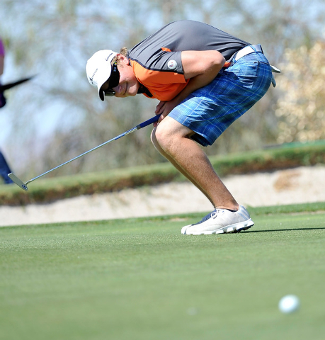 Bishop Gorman's Frank Frisbee reacts to his putt on the fifth hole during the final round of the Sunset Region tournament on Tuesday. Frisbee shot a two-day 148 to finish tied for fifth. (David Be ...
