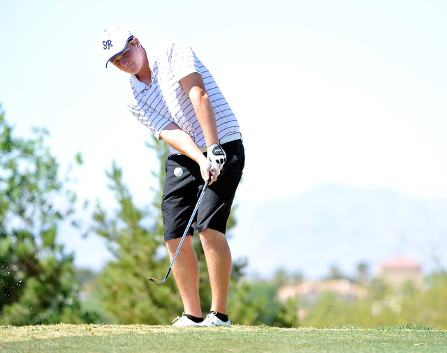 Shadow Ridge's Benjamin Davis chips on the fourth hole during the final round of the Sunset Region tournament on Tuesday. Davis shot 142 and won the tournament on a two-hole playoff. (David Becker ...