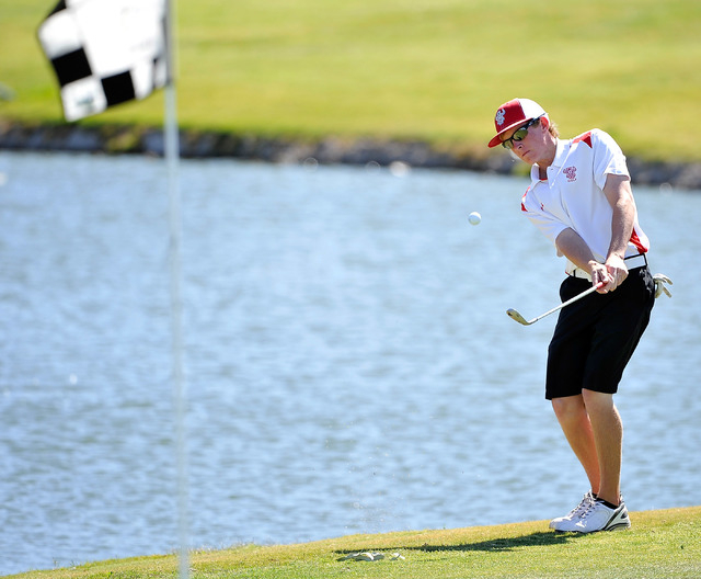Arbor View's Sam Dickey shoots pitches on the fourth hole during the final round of the Sunset Region tournament on Tuesday, May 13. Dickey shot 145 to finish third. (David Becker/Las Vegas Review ...