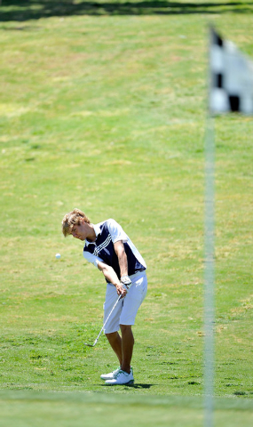 Boulder City's Luke Logan shoots on the fifth hole during the final round of the Division I-A Southern Region tournament on Tuesday. Logan shot 149 to win the tournament by three strokes. (David B ...
