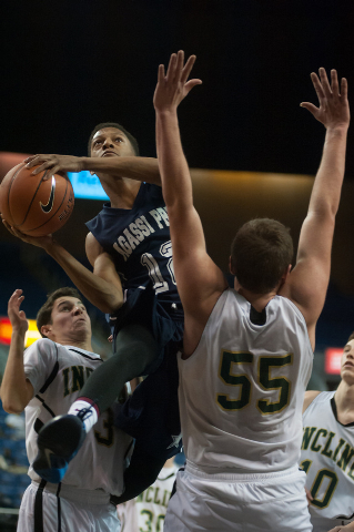 Agassi Prep's Kobe Williams (12) tries to shoot around Incline's Ben Snyder (55) during the Division III state final on Saturday. Agassi defeated Incline 71-60. (Kevin Clifford/Las Vegas Review-Jo ...