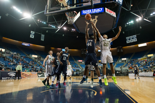 Agassi Prep's Dennis Walker (44) goes against Incline's Orin Porter (20) for a rebound during the Division III state final on Saturday. Agassi defeated Incline 71-60. (Kevin Clifford/Las Vegas Rev ...