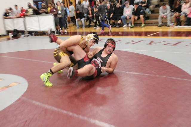 Bonanza 220-pounder Elias Aguilar takes down Desert Oasis' Andrew Dean with a single-leg shot in the opening round of the Sunset Region wrestling tournament at Cimarron-Memorial on Friday. (W.G. R ...