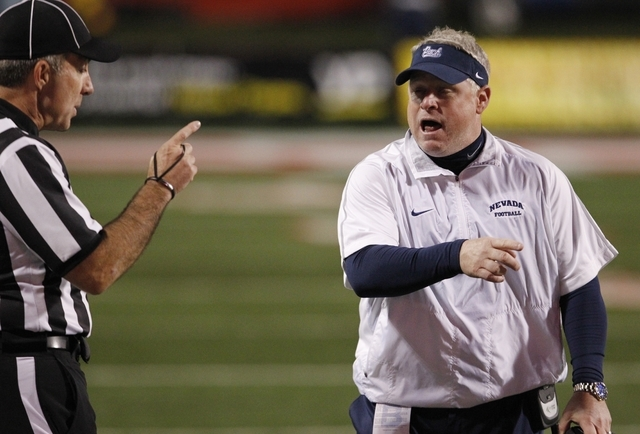 UNR coach Brian Polian speaks with an official during the second half of an NCAA college football game against Fresno State, Thursday, Nov. 5, 2015, in Fresno, Calif. (AP Photo/Gary Kazanjian)