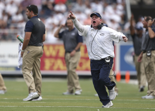 In this Saturday, Sept. 12, 2015, photo, Nevada coach Brian Polian yells to an official during an NCAA college football game against Arizona in Reno, Nev. The Mountain West Conference has fined Po ...