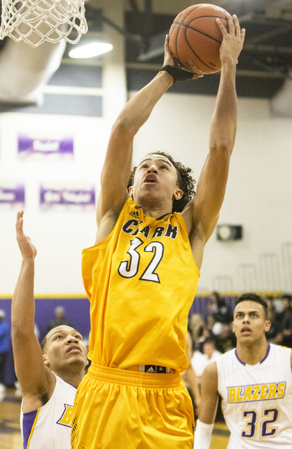 Clark's Ian Alexander (32) shoots over Durango's Demetrius Valdez (13) and Jeremie Portuondo (32) during the Chargers road matchup with the Trailblazers on Monday, Jan. 23, 2017, at Durango High S ...