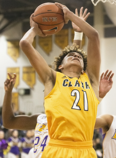 Clark's Jalen Hill (21) grabs a rebound during the Chargers road matchup with the Durango Trailblazers on Monday, Jan. 23, 2017, at Durango High School, in Las Vegas. Benjamin Hager/Las Vegas Revi ...