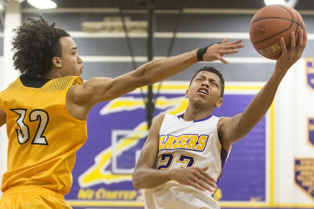 Durango's Nicquel Blake (23) slices to the rim past Clark's  Ian Alexander (32) during the Trailblazers home matchup with the Chargers on Monday, Jan. 23, 2017, at Durango High School, in Las Vega ...