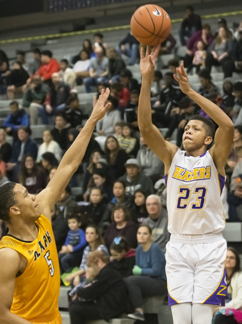 Durango's Nicquel Blake (23) shoots a corner three over Clark's Deshawn Wilson (5) during the Trailblazers home matchup with the Chargers on Monday, Jan. 23, 2017, at Durango High School, in Las V ...