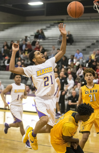 Durango's Anthony Hunter (21) elevates for a rebound over Clark's Jalen Hill (21) during the Trailblazers home matchup with the Chargers on Monday, Jan. 23, 2017, at Durango High School, in Las Ve ...