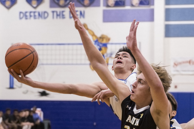 Sierra Vista's Maka Ellis, behind, makes an acrobatic layup over Faith Lutheran's Nic Maccioni on Tuesday, Nov. 29, 2016, at Sierra Vista High School in Las Vegas. Benjamin Hager/Las Vegas Review- ...