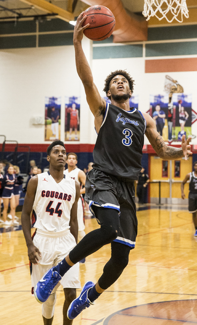 Desert Pines' Trevon Abdullah-Booker (3) drives to the basket past Coronado's Taieem Comeaux (44) on Monday, Dec. 12, 2016, at Coronado High School, in Henderson. Benjamin Hager/Las Vegas Review-J ...