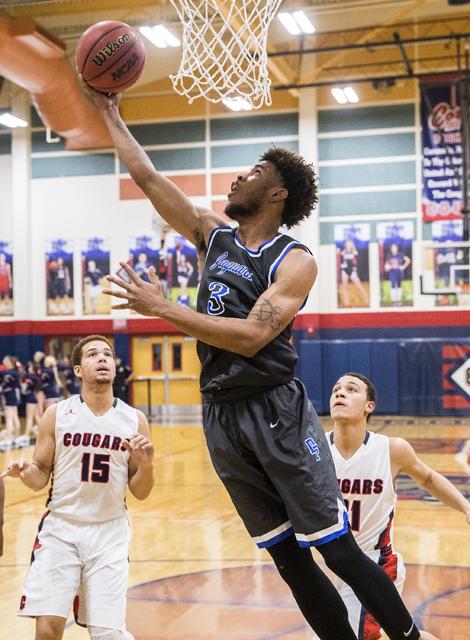 Desert Pines' Trevon Abdullah-Booker (3) drives baseline past Coronado defenders on Monday, Dec. 12, 2016, at Coronado High School, in Henderson. Benjamin Hager/Las Vegas Review-Journal