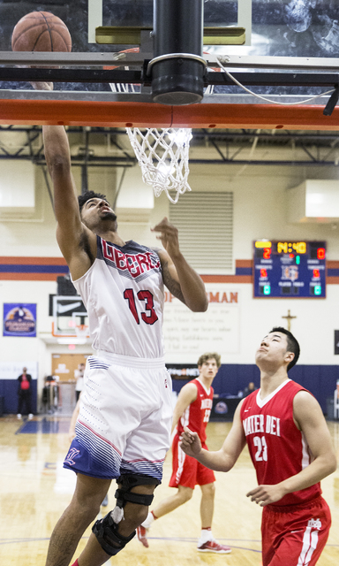 Liberty's Dyllan Robinson (13) drives past Mater Dei's Michael Wang (23) during the Tarkanian Classic on Thursday, Dec. 15, 2016, at Bishop Gorman High School, in Las Vegas. Benjamin Hager/Las Veg ...