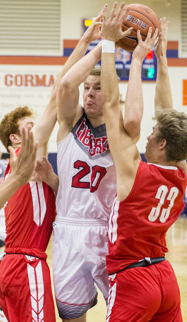 Liberty's Logan Koch (20) gets tied up with Mater Dei's Reagan Lundeen (33) during the Tarkanian Classic on Thursday, Dec. 15, 2016, at Bishop Gorman High School, in Las Vegas. Benjamin Hager/Las  ...