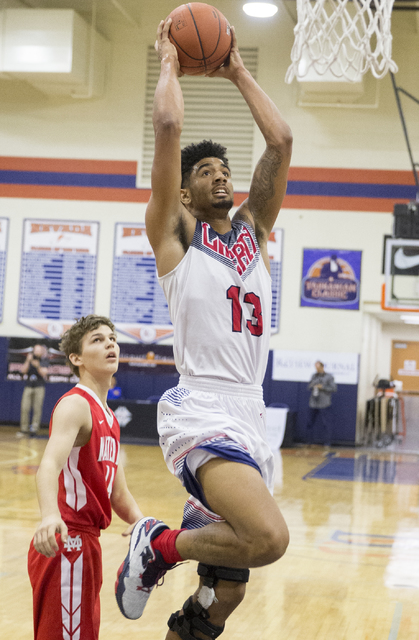 Liberty's Dyllan Robinson (13) converts a fast break layup during the Tarkanian Classic on Thursday, Dec. 15, 2016, at Bishop Gorman High School, in Las Vegas. Benjamin Hager/Las Vegas Review-Journal