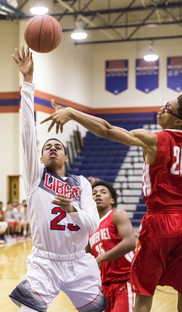 Liberty's Julian Strawther (23) drives past Mater Dei's Miles Brookin (20) during the Tarkanian Classic on Thursday, Dec. 15, 2016, at Bishop Gorman High School, in Las Vegas. Benjamin Hager/Las V ...
