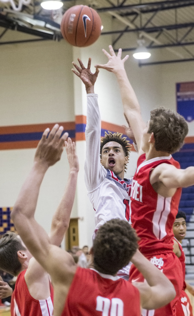 Liberty's Jordan Holt (10) shoots over a group of Mater Dei defenders during the Tarkanian Classic on Thursday, Dec. 15, 2016, at Bishop Gorman High School, in Las Vegas. Benjamin Hager/Las Vegas  ...