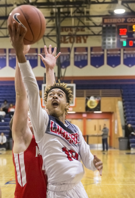 Liberty's Jordan Holt (10) converts a fast break layup  during the Tarkanian Classic on Thursday, Dec. 15, 2016, at Bishop Gorman High School, in Las Vegas. Benjamin Hager/Las Vegas Review-Journal