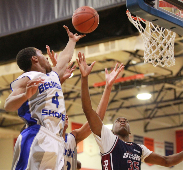 Belmont Shore's Nick Blair (4) reaches to tip in a shot over Upward Stars' Malik Dunbar (35) in the Fab 48 tournament at Bishop Gorman on Thursday. (Chase Stevens/Las Vegas Review-Journal)