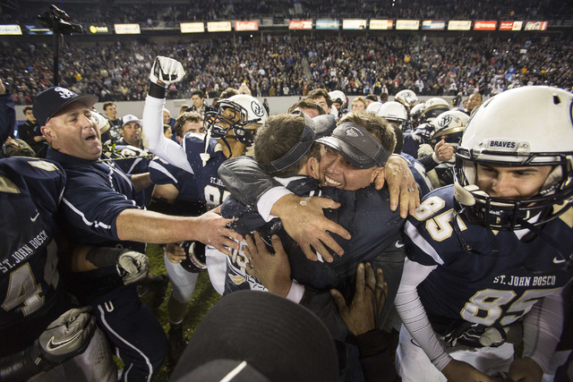 St. John Bosco's head coach Jason Negro celebrates with his team after defeating De La Salle in the CIF Open Division high school football championship game in Carson, Calif., Saturday, Dec. 21, 2 ...