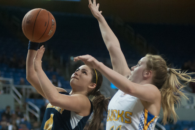 Boulder City's Katlyn Daly (4) goes for a shot against Lowry's Kylee McClellan (11) during the Division I-A state final on Saturday. Lowry defeated Boulder City 44-34. (Kevin Clifford/Las Vegas Re ...