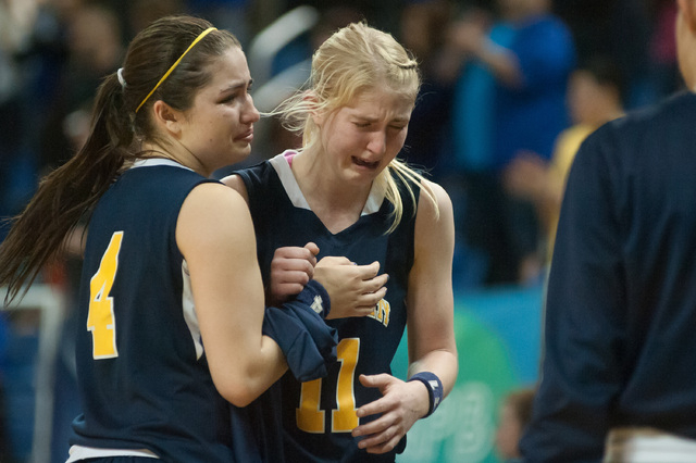 Boulder City's Jana Williams (11) cries while being helped off the court by teammate Katlyn Daly (4) in the final seconds against Lowry during the Division I -A state finals on Saturday, March 1,  ...