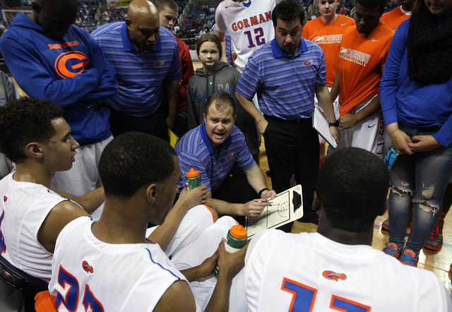 Bishop Gorman coach Grant Rice talks to his team during a timeout on Friday. Bishop Gorman defeated Canyon Springs 71-58 to win the Division I state title. (Cathleen Allison/Las Vegas Review-Journal)