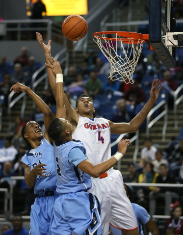 Bishop Gorman's Chase Jeter shoots over Canyon Springs defenders Darrell McCall and Jordan Davis during the Division I state title game on Friday. Jeter had 21 points, 19 rebounds and four blocked ...