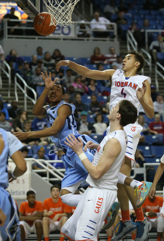Canyon Springs' Darrell McCall shoots around Bishop Gorman defenders Chase Jeter (4) and Stephen Zimmerman during the Division I championship game on Friday night. Gorman won the title 71-58. (Cat ...