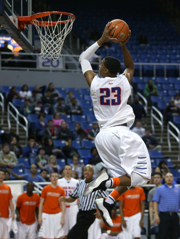 Bishop Gorman's Nick Blair slam dunks in the Division I NIAA state championship game against Canyon Springs at the Lawlor Events Center, in Reno, Nev., on Friday, Feb. 28, 2014. Bishop Gorman won  ...