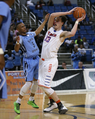 Canyon Springs' Gerad Davis and Bishop Gorman's Stephen Zimmerman compete during the Division I championship game on Friday. Zimmerman had 11 points, 13 rebounds and three blocked shots as Gorman  ...