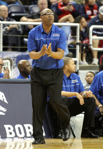 Canyon Springs coach Freddie Banks works the sidelines during the Division I state championship game. Bishop Gorman defeated Canyon Springs 71-58. (Cathleen Allison/Las Vegas Review-Journal)