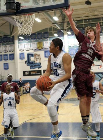 Centennial's Eddie Davis (50) goes up for a shot past Cimarron-Memorial forward Kyle Skurow (21) this past season. Davis averaged 11.9 points and 8.3 rebounds as a senior, and recently signed with ...