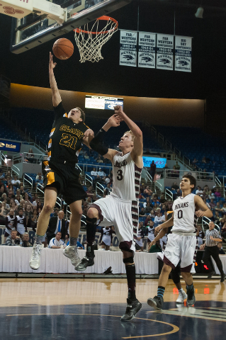 Clark's Cater Olsen (21) shoots against Elko's Marshall Dumas (3) during the Division I -A state final on Saturday. Clark defeated Elko 43-25. (Kevin Clifford/Las Vegas Review-Journal)