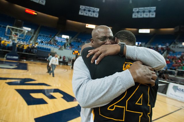David Jones, father of Diontae Jones (24), cries while celebrating with his son after Clark defeated Elko 43-25 in the Division I -A state championship game on Saturday. (Kevin Clifford/Las Vegas  ...