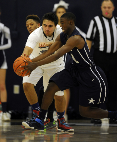 The Meadows School center Alex Agrawal, left, and Agassi Prep guard Cajon Lakes battle for a loose ball in the second quarter on Saturday. Lakes scored six of his eight points in the fourth quarte ...