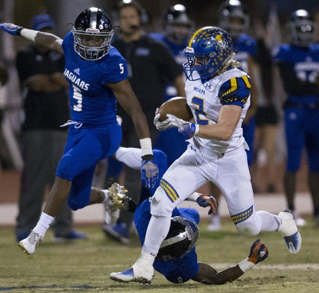 Moapa Valley's Jacob Leavitt (2) runs the ball against Desert Pines in their state quarterfinal football game at Desert Pines High School on Friday, Nov. 4, 2016, in Las Vegas. Erik Verduzco/Las V ...