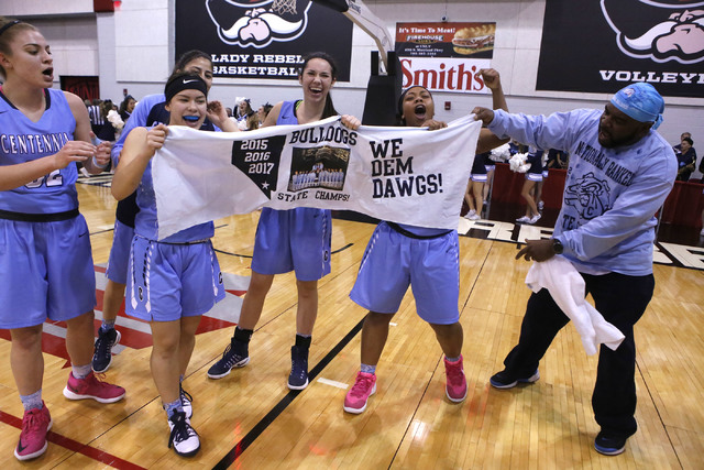 Centennial players celebrate after winning their third straight Class 4A girls state final championship game at the Cox Pavillion on Friday, Feb. 24, 2017, in Las Vegas. Centennial won 97-52. (Chr ...