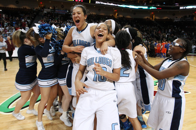Jayden Eggleston (10), Karina Brandon (left) and Tanjanae Wells (00) celebrate along with their Centennial teammate after a 65-52 win over Bishop Gorman in the Division I state championship game F ...