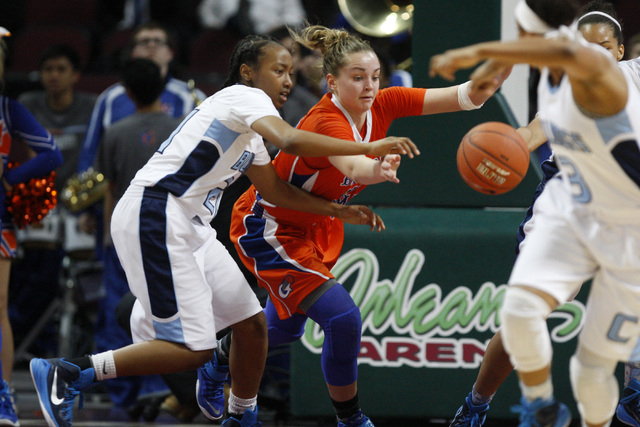 Centennial guard Justice Ethridge and Bishop Gorman guard Megan Jacobs chase a loose ball during their Division I state championship game Friday, Feb. 27, 2015, at the Orleans Arena. Ethridge had  ...