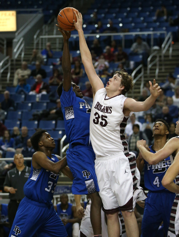 Elko's Brian Pearson blocks a shot from Desert Pines' Re'meake Keith during the Division I-A state semifinals on Friday. Pearson had 11 blocked shots as Elko won 63-47 to advance to the state cham ...