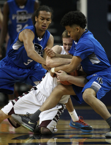 Elko's Cody Nielsen wrestles for a loose ball with Desert Pines' Kevin Butler, left, and Capri Uzan during the Division I-A state semifinals on Friday. Elko won 63-47 to advance to the state champ ...