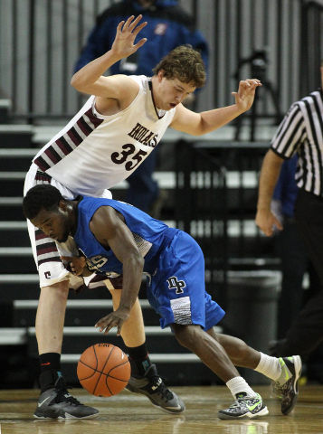 Desert Pines' Malik Davis tries to push past Elko defender Brian Pearson during the Division I-A state semifinals. Elko won 63-47 to advance to the state championship game. (Cathleen Allison/Las V ...