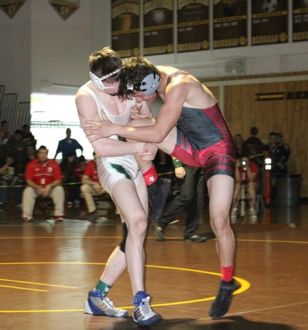 Arbor View's Tyler Roper (right) battled Palo Verde's Tyler Dinsmore until the finish, when he scored a takedown with two seconds left to secure the 145-pound title at the Sunset Regional at Bonan ...