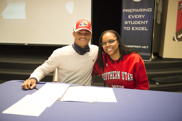 Agassi Prep's Zeivaun Ned, left, poses after signing with Southern Utah to play football. (Courtesy Zach Reininger)