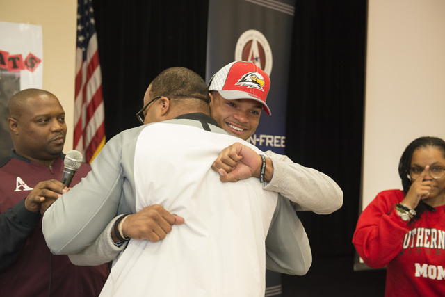 Agassi Prep's Zeivaun Ned receives a hug after signing to play football at Southern Utah. (Courtesy Zach Reininger)